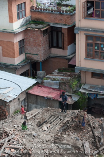 Family recovering and removing materials from a building destroyed in the Nepal Earthquake of 25th April 2015.